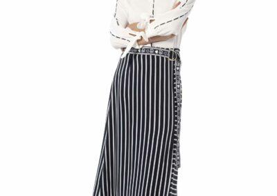 Caroline Biss, blouse en gestreepte rok